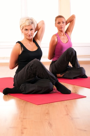 Group of people doing fitness exercise  photo