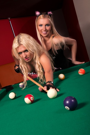 Happy girls playing in billiard  photo