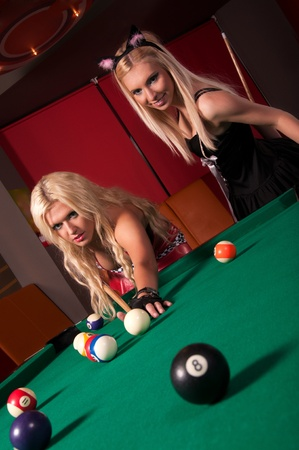 hen party: Happy girls playing in billiard