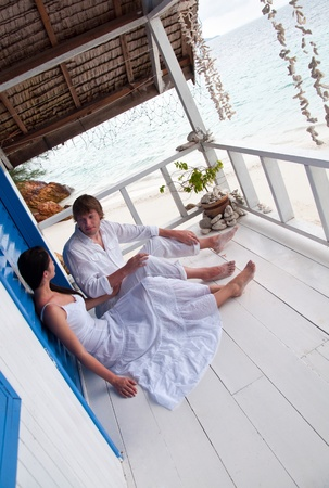 Romantic young couple in tropical beach house Stock Photo - 12779958