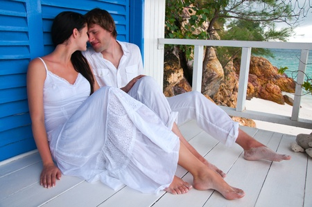 Romantic young couple in tropical beach house photo