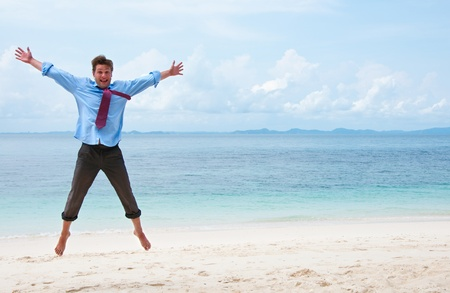 jump suit: Funny business man jumping on the beach
