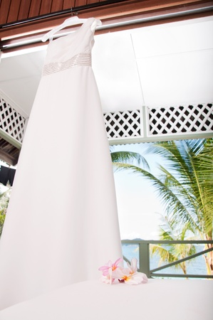 Picture of wedding dress on tropical sea view background photo