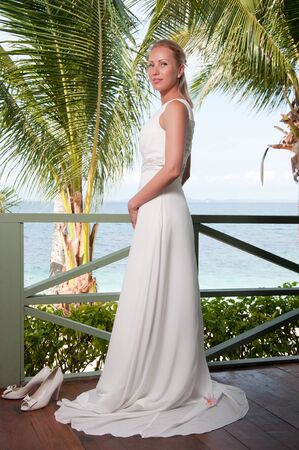 Beautiful bride on tropical sea side background photo