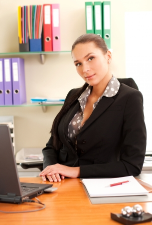 Business woman sitting in the office in front of the laptop  photo