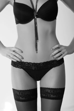 Beautiful and sexy woman wearing black lingerie  photo