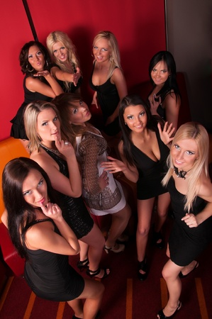 Image of pretty girls dancing in night club photo
