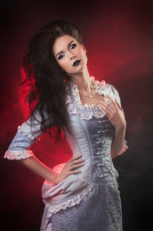 aristocratic: portrait of halloween vampire woman aristocrat with stage makeup