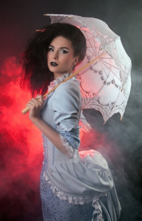 beautiful vampire: Beautiful Halloween vampire woman aristocrat with lace-parasol