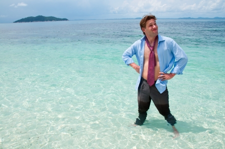 Funny business man on the beach photo