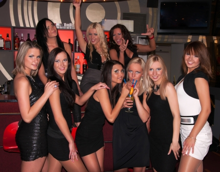 Girls company having fun in the night club photo