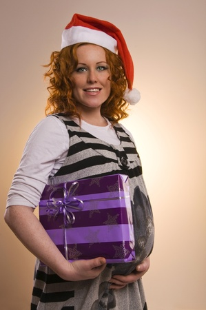 Beautiful excited Santa girl with a presents Stock Photo - 15487716