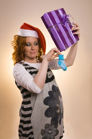 Beautiful excited Santa girl with a presents Stock Photo - 15487725