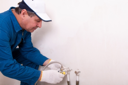 Plumber fixing water pipe Stock Photo - 15654166