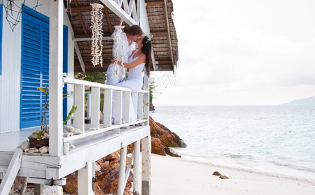 kiss couple: Romantic young couple in tropical beach house