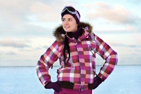 Beautiful young woman wearing skiing suit posing outdoors in winter Stock Photo - 15654228