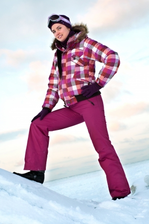 Smiling young woman wearing skiing suit posing outdoors in winter Stock Photo - 15654204