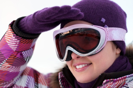 Portrait of smiling happy young woman wearing ski goggles Stock Photo - 15654198