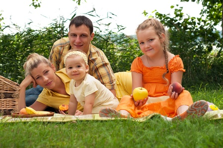 Happy family picnicking outdoors photo