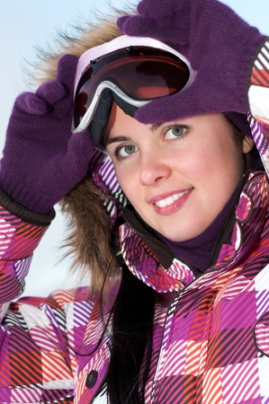 Portrait of smiling happy young woman wearing ski goggles Stock Photo - 15654229