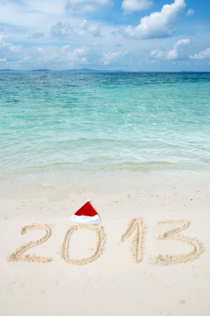 Numbers 2013 on tropical beach sand  photo
