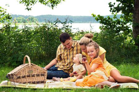 family picnic: Happy family picnicking outdoors