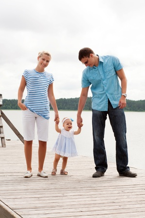 river bank: Happy family on the river bank