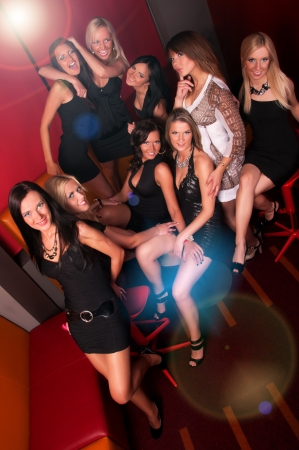Image of pretty girls having fun in night club photo