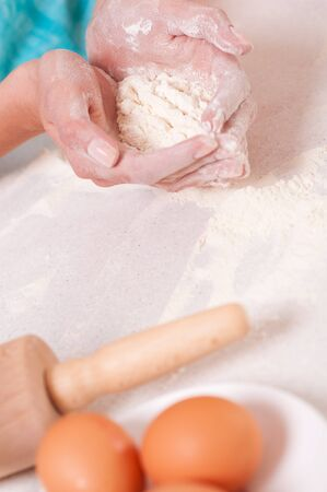 Woman hands preparing dough on the table  photo
