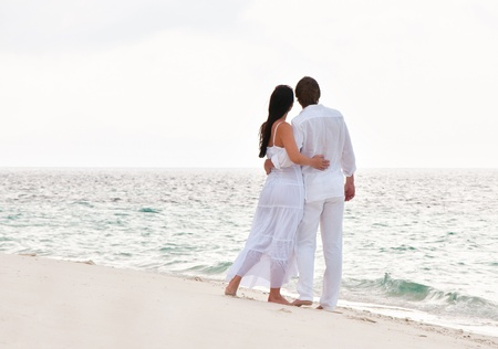 back  view: Picture of romantic young couple on the sea shore