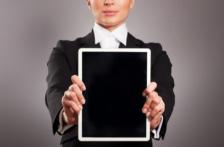 A young businesswoman holding her digital tablet pc photo