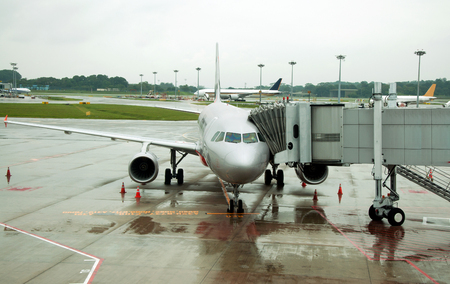 Parked aircraft on Singapore airport photo