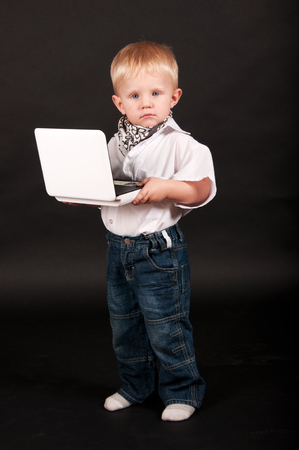 kid businessman with a laptop photo