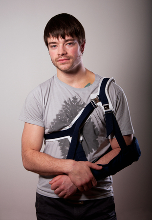 Portrait of young man with broken hand photo