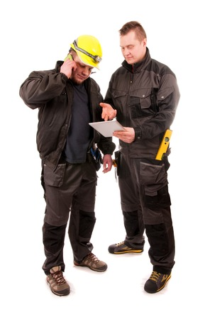 Two Engineers looking at tablet pc isolated on white background photo