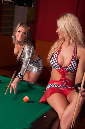 pool ball: Girls playing in billiard  Stock Photo