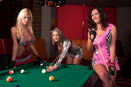billiard ball: Girls playing in billiard  Stock Photo