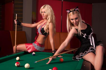 night stick: Girls playing in billiard  Stock Photo