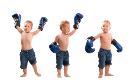 boy boxing: Young kid with boxing gloves in winning poses