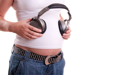 Pregnant woman belly with headset  photo