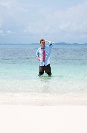 Business man on the beach  photo