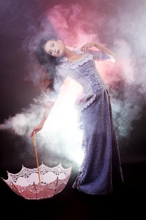 Beautiful Halloween vampire woman aristocrat on black background Stock Photo