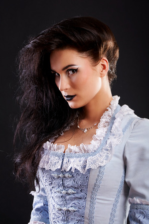 portrait of vampire woman aristocrat with stage makeup isolated on black Stock Photo