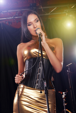 Beautiful young girl performing on the stage photo