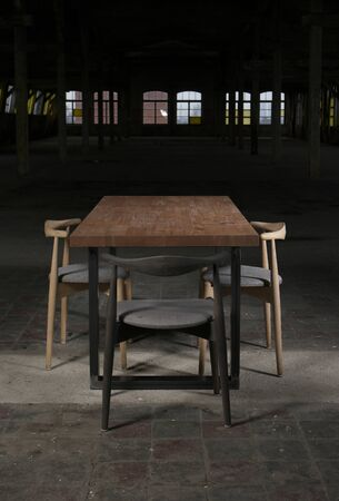 old furniture: modern wooden table in the loft Stock Photo