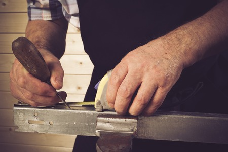 manual measuring instrument: Senior carpenter working in workshop