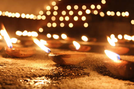 spiritual bless: oil candles nearby a temple in India on holy night