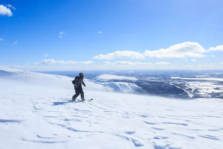 descent: snowboarder descent the snow mountain and picturesque polar landscape around Stock Photo
