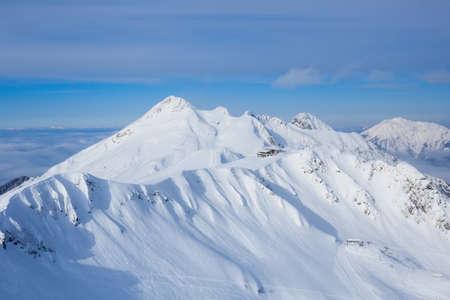 ski lodge: lodge in mountain covered with snow in mountain ski resort Rosa Khutor Sochi