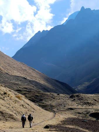 two man walking through the mountain